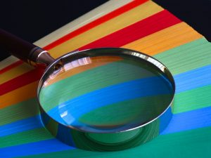 Magnifying glass on colored paper
