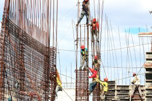 construction workers building a structure